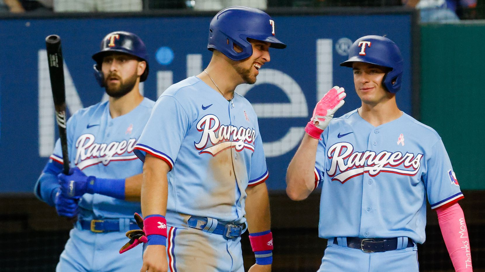 Texas Rangers second baseman Nick Solak (15) and Texas Rangers first baseman Nate Lowe (30) smile after scoring off Texas Rangers right fielder Adolis García (53) homer to left center against the Seattle Mariners at the bottom of the fifth at Globe Life Field on Sunday, May 9, 2021, in Arlington.  scored on the hit. The Rangers won, 10-2. (Juan Figueroa/The Dallas Morning News)