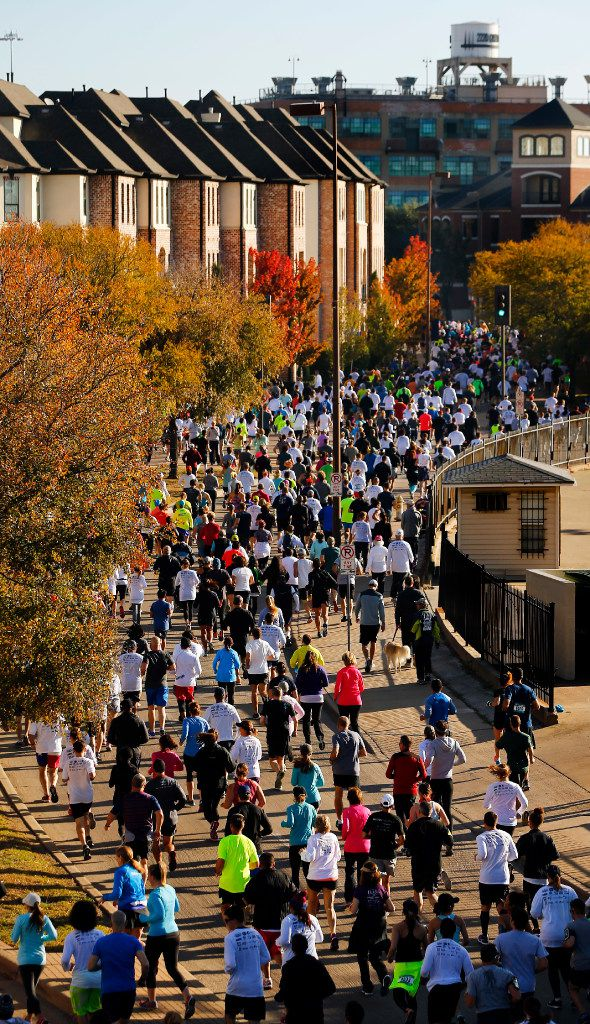 Runners filled eastbound Young Street after starting the 8-mile run during the 49th annual Dallas YMCA Turkey Trot in downtown Dallas last year.