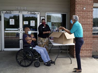 "Marsha Evans (right), Friendly Visitor Program manager for the Senior Source, shares a safe ""hug"" with Modern Senior Living resident Willie Wilson (left) and administrator Monté Mitchell. Evans was delivering donations.."