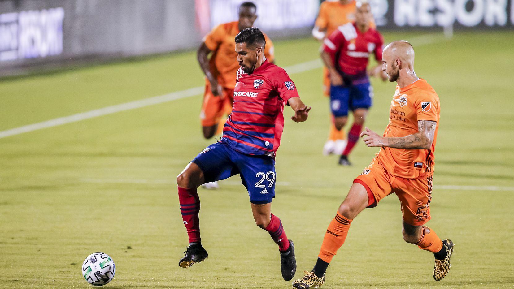 FC Dallas attacker Franco Jara (29) looks for room against Houston Dynamo defender Aljaz Struna (5) during the first half of an MLS soccer match at Toyota Stadium in Frisco, Saturday, September 12, 2020.