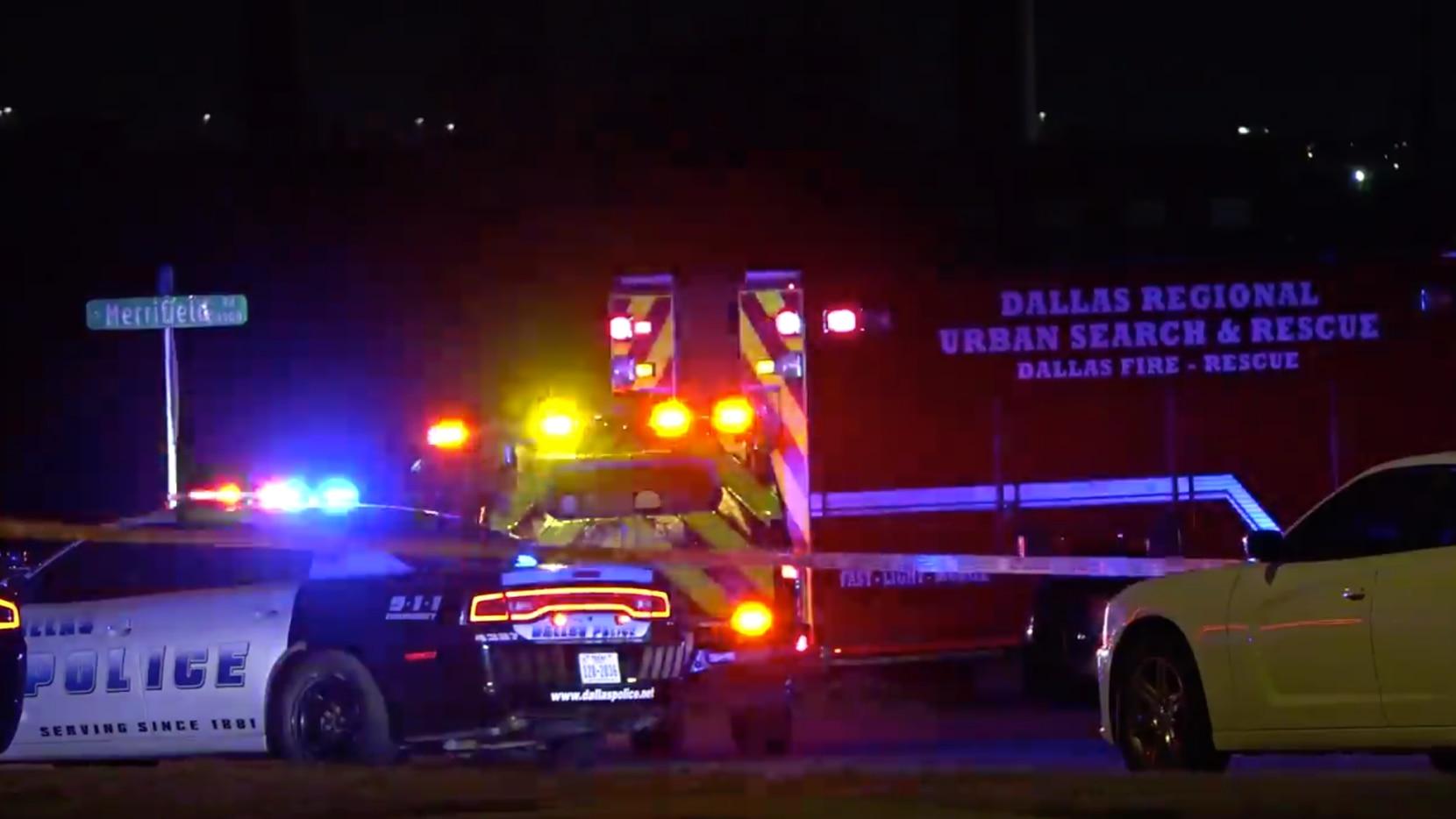 A Dallas police car and a Dallas Fire-Rescue ambulance at the scene of a fatal crash late Saturday in southwestern Dallas.