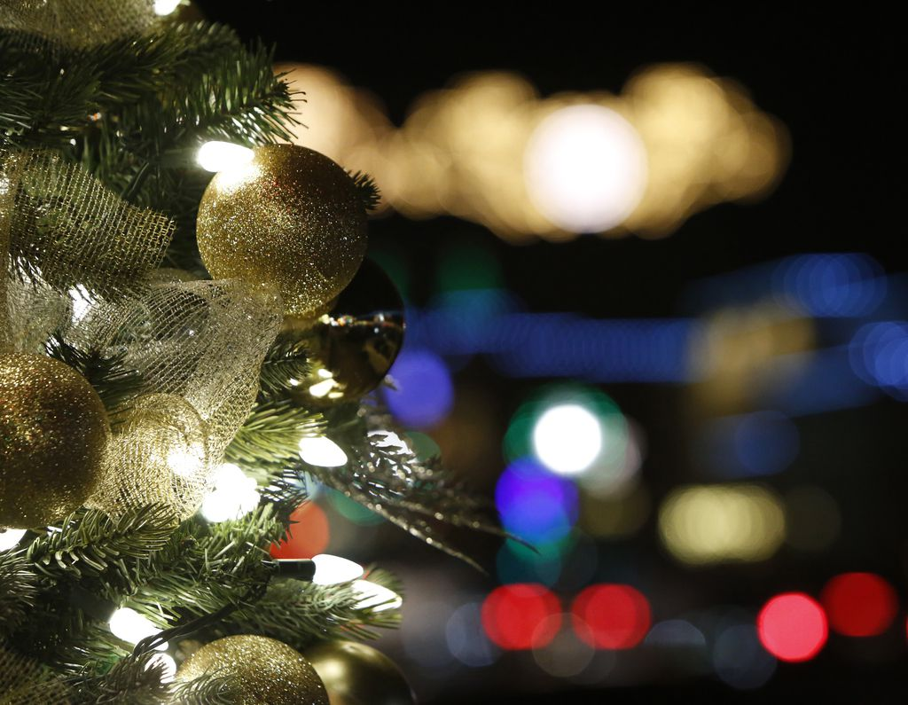 A decorated Christmas tree glows in front of a bevy of holiday lights as businesses in the downtown Grapevine area go to great lengths to promote holiday cheer.  The twinkle light board parade was photographed from the Glass Cactus Nightclub at the Gaylord Texan resort in Grapevine on December 1, 2018.  (Steve Hamm/ Special Contributor)