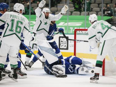 Dallas Stars defenseman Miro Heiskanen (4) scores during the second period of an NHL hockey game against the Tampa Bay Lightning in Dallas, Tuesday, March 16, 2021.