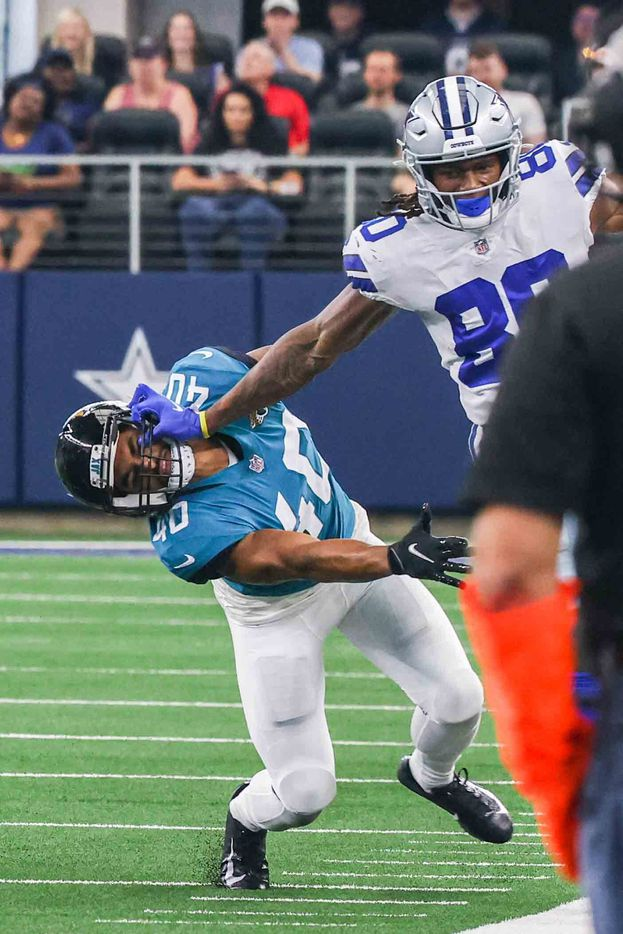 Dallas Cowboys wide receiver Brandon Smith, 80, pushes Jacksonville Jaguars' Brandon Rusnak, 40, from his helmet during the 3rd quarter of a preseason game at AT&T stadium in Arlington on Sunday, August 29, 2021. (Lola Gomez/The Dallas Morning News)