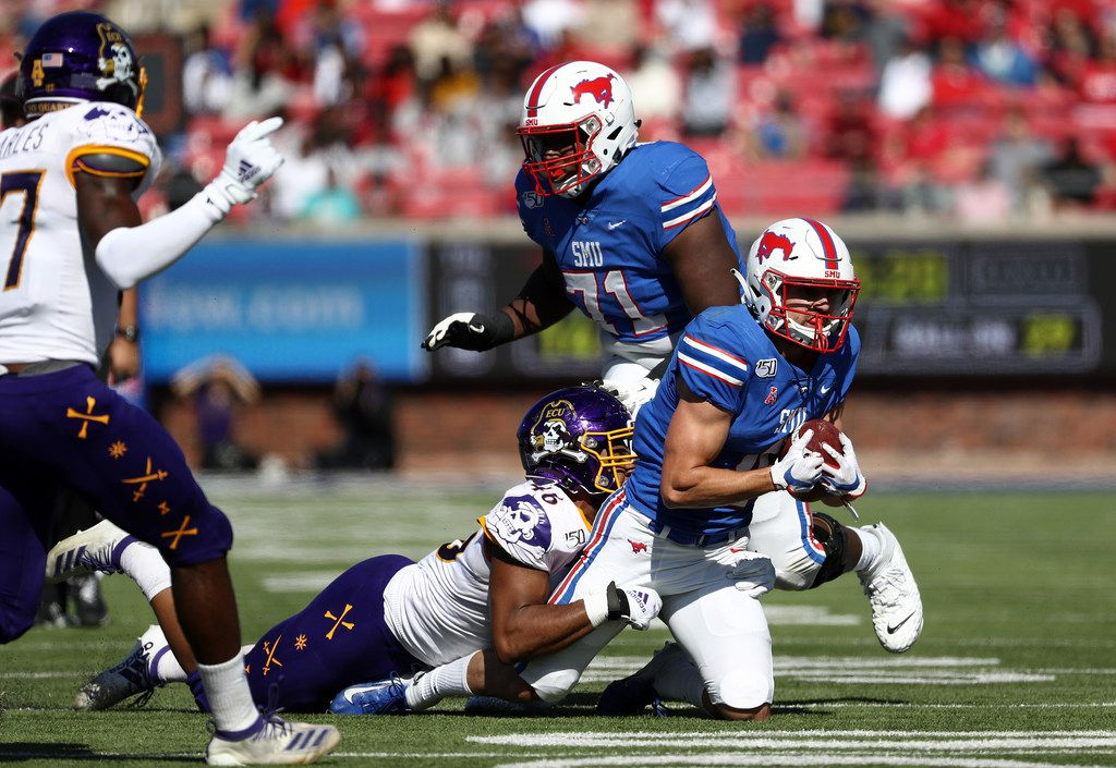 DALLAS, TEXAS - NOVEMBER 09:  Tyler Page #4 of the Southern Methodist Mustangs runs the ball against Chance Purvis #46 of the East Carolina Pirates in the first half at Gerald J. Ford Stadium on November 09, 2019 in Dallas, Texas. (Photo by Ronald Martinez/Getty Images)