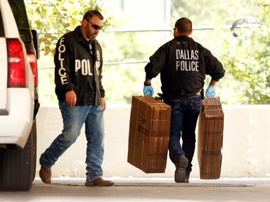 "Dallas police officials carry cardboard boxes Wednesday into the Catholic Diocese of Dallas as they continued to gather evidence. Dallas police on Wednesday morning raided several Dallas Catholic Diocese offices after a detective said church officials have ""thwarted"" his investigations into allegations of sexual abuse by priests. Dallas Bishop Edward J. Burns said at an afternoon news conference that the diocese had given personnel files ""for all the priests named in the warrant"" and had been has been cooperating with the police requests."
