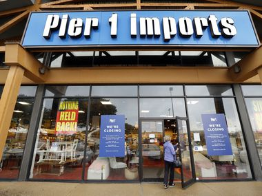 Store closing and sale posters hung in the windows of the Pier 1 store on S. Cooper St. in Arlington in January. (Tom Fox/The Dallas Morning News)
