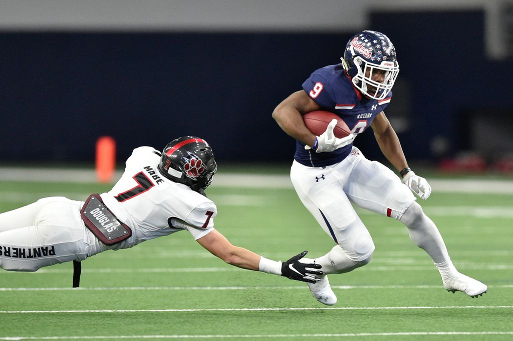 Ryan running back Emani Bailey (9) carries the ball and evades being tackled by Heritage safety Luke Mabe (7) at the Ford Center at the Star, Dec. 7, 2019, in Frisco, Texas.