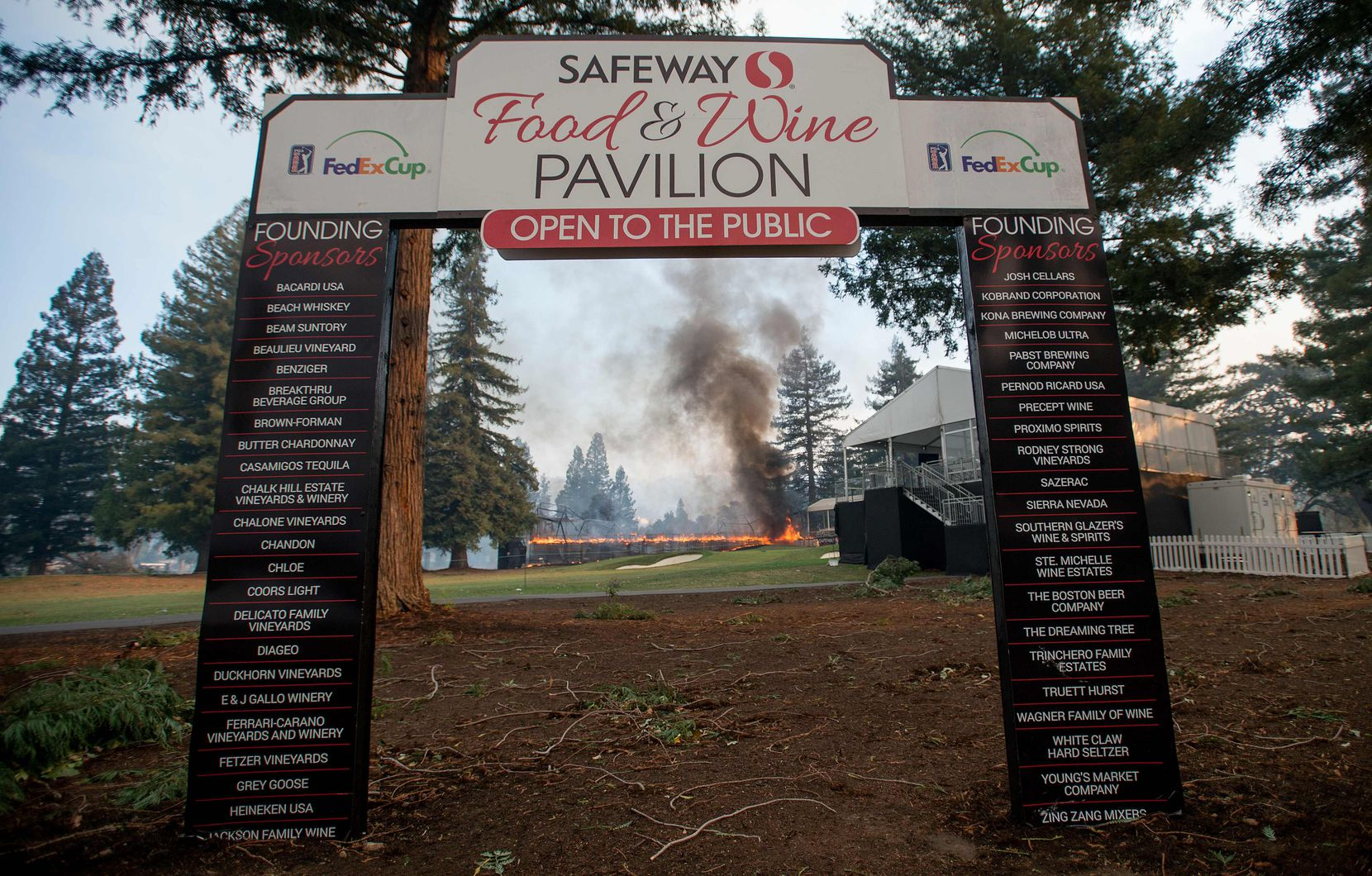 A tent structure built for the 2017 Safeway Open burns on a golf course at the Silverado Resort and Spa in Napa, California on October 9, 2017, as multiple wind-driven fires continue to whip through the region.