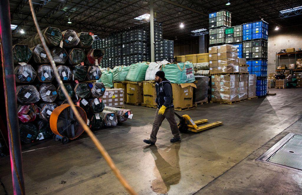 Francisco Garza walks through Bespoke Logistics' warehouse in McAllen.
