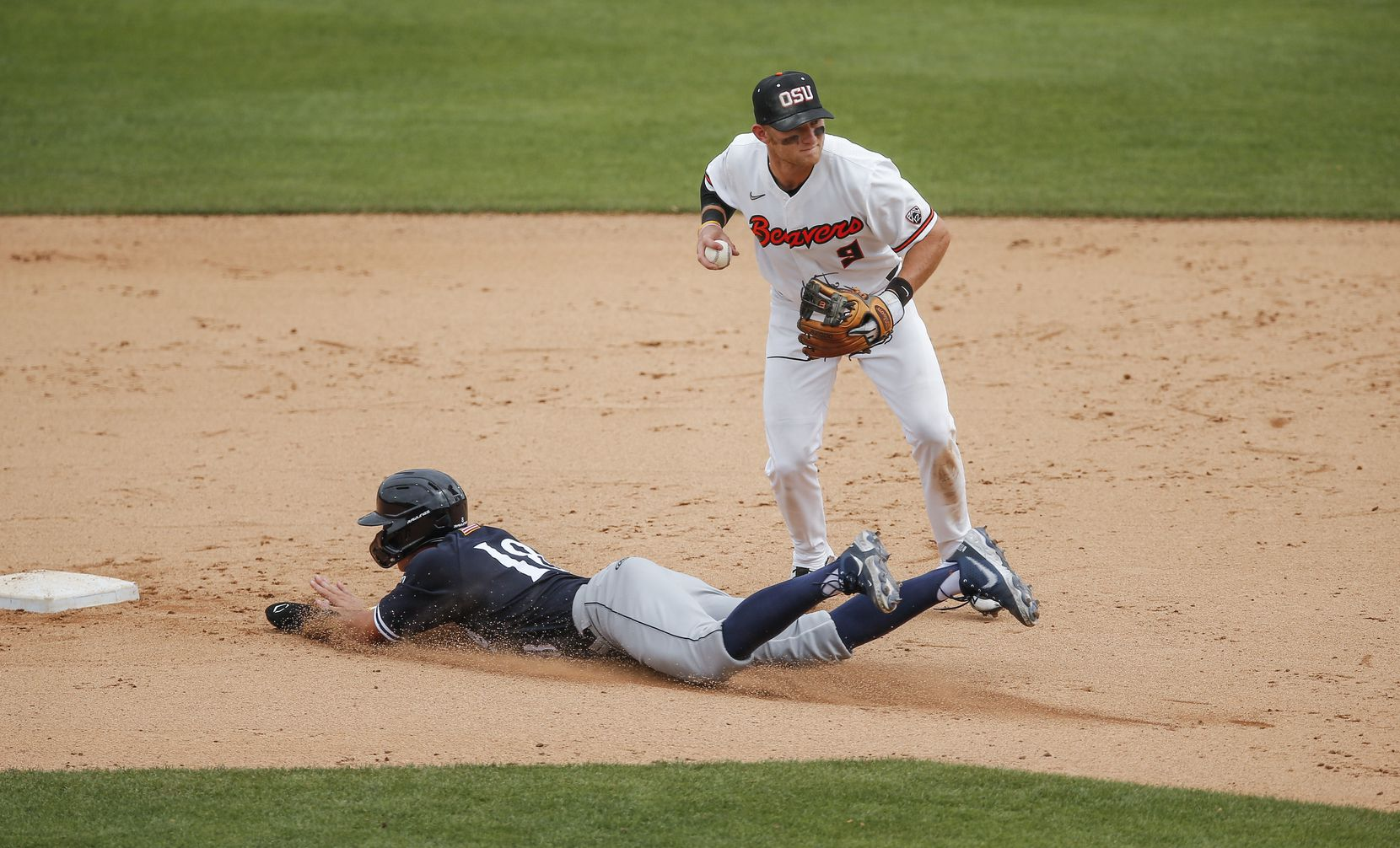 Oregon St. infielder Andy Armstrong (9) throws to first for a double play after forcing out DBU's Cole Moore (19) at second in the ninth inning during the NCAA Fort Worth Regional baseball tournament at TCU's Lupton Stadium in Fort Worth, Friday, June 4, 2021. Dallas Baptist won 6-5. (Brandon Wade/Special Contributor)