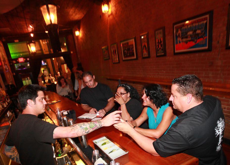 Gabe Sanchez, far left, opened Black Swan Saloon in 2010.