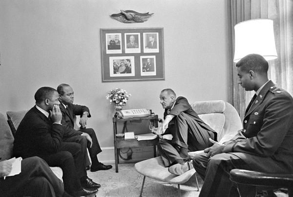 President Lyndon Johnson met with (from left) John Lewis, James Farmer and Hugh Robinson at the White House on Aug. 6, 1965, the day the Voting Rights Act was signed. Johnson's extensive domestic agenda included several pieces of civil rights legislation.