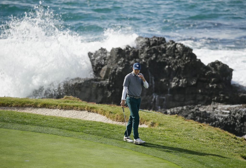 Jordan Spieth looks over the seventh green of the Pebble Beach Golf Links during the third round of the AT&T Pebble Beach Pro-Am golf tournament Saturday, Feb. 9, 2019, in Pebble Beach, Calif. (AP Photo/Eric Risberg)