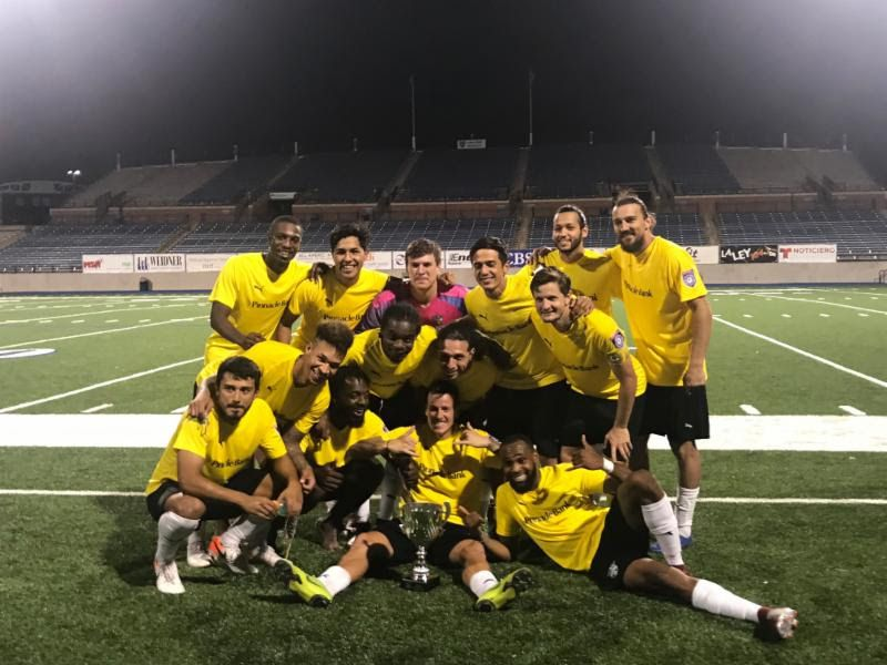 Fort Worth Vaqueros players pose for a photo with the NPSL Lone Star Conference trophy.