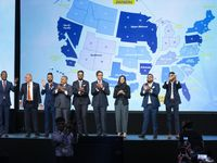 Representatives of the Asian American Hotel Owners Association, Texas Division, take the stage during their convention in Dallas on Wednesday.
