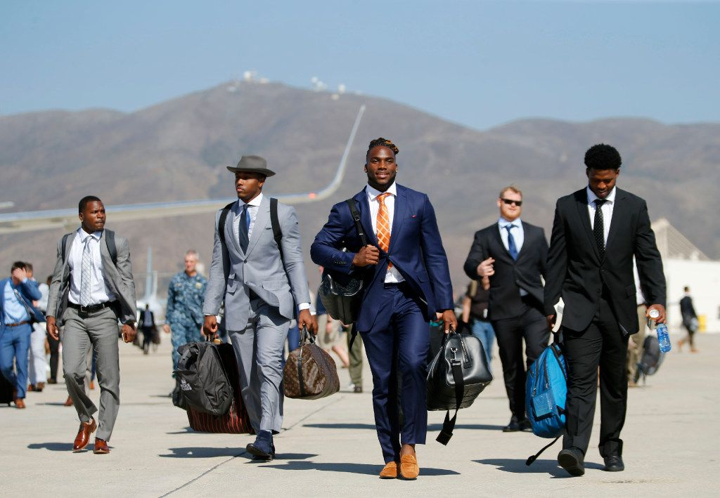 Dallas Cowboys defensive end Taco Charlton (L-R, beginning with 2nd from left), Dallas Cowboys linebacker Jaylon Smith and Dallas Cowboys Rod Smith arrival at Naval Air Station Point Mugu in Point Mugu, California on Saturday, July 22, 2017. Dallas Cowboys training camp begins on Monday. (Vernon Bryant/The Dallas Morning News)
