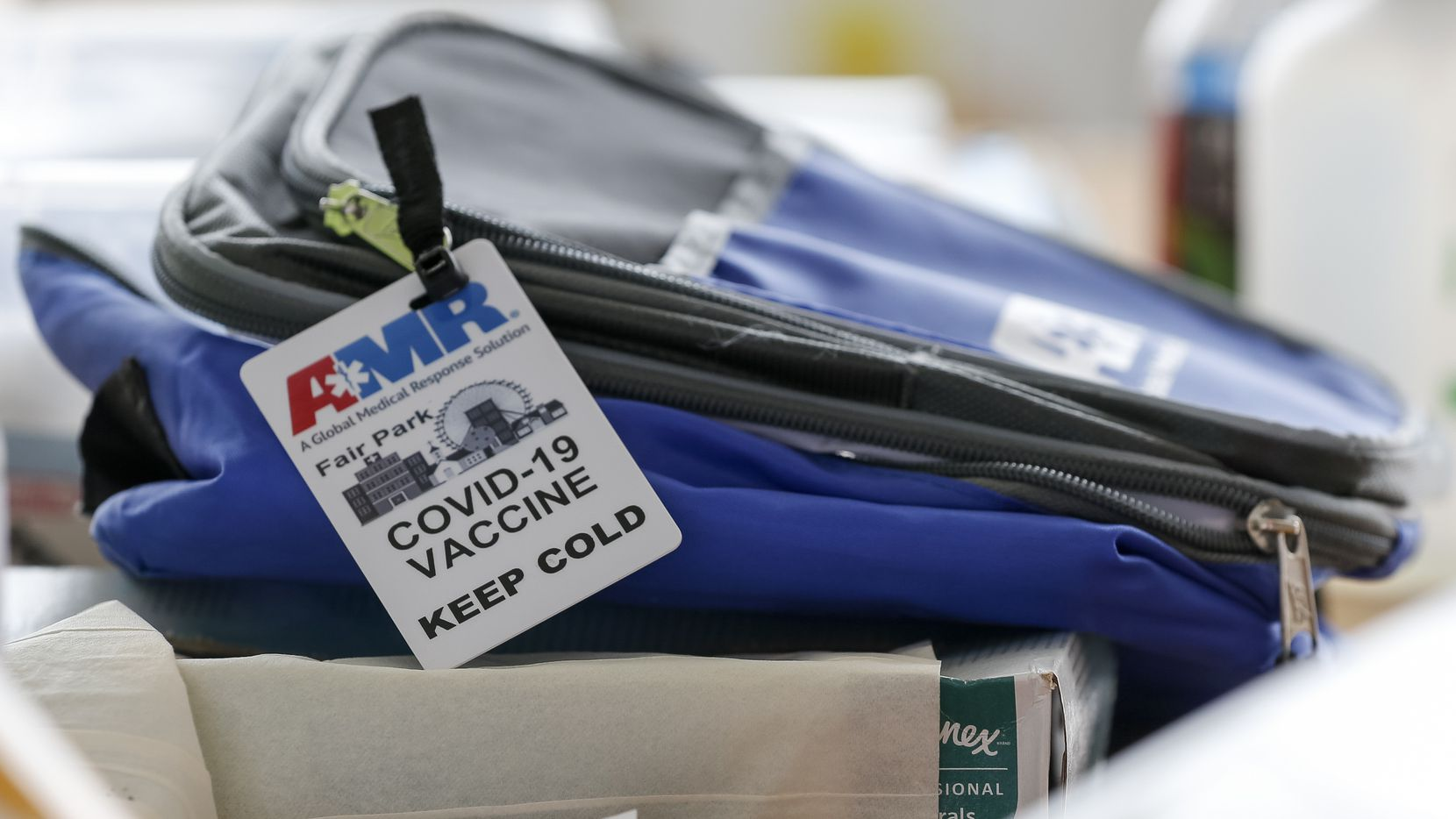 A bag containing COVID-19 vaccines rests on a table during the last day of vaccinations at the drive-thru Fair Park site on Saturday, July 17, 2021, in Dallas. More than 12,000 doses could be administered at the site during its peak. (Elias Valverde II/The Dallas Morning News)