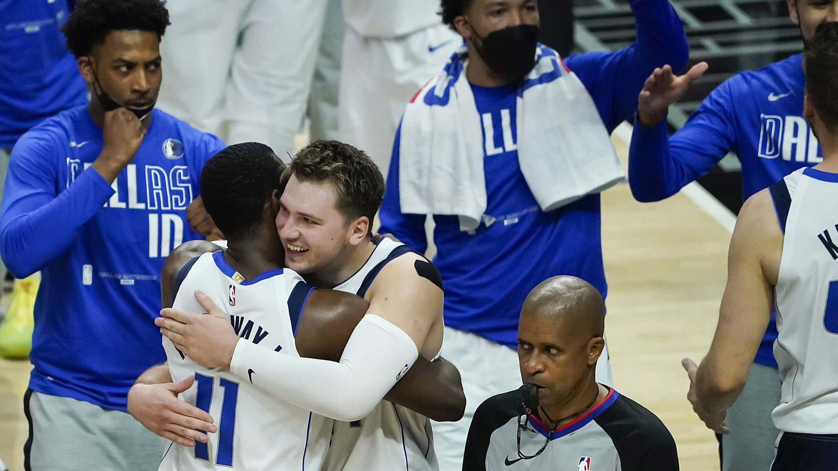 Dallas Mavericks guard Luka Doncic celebrates with forward Tim Hardaway Jr. (11) after the final buzzer of a win over the LA Clippers during in an NBA playoff basketball game at the Staples Center on Wednesday, June 2, 2021, in Los Angeles. The Mavericks won the game 105-100.
