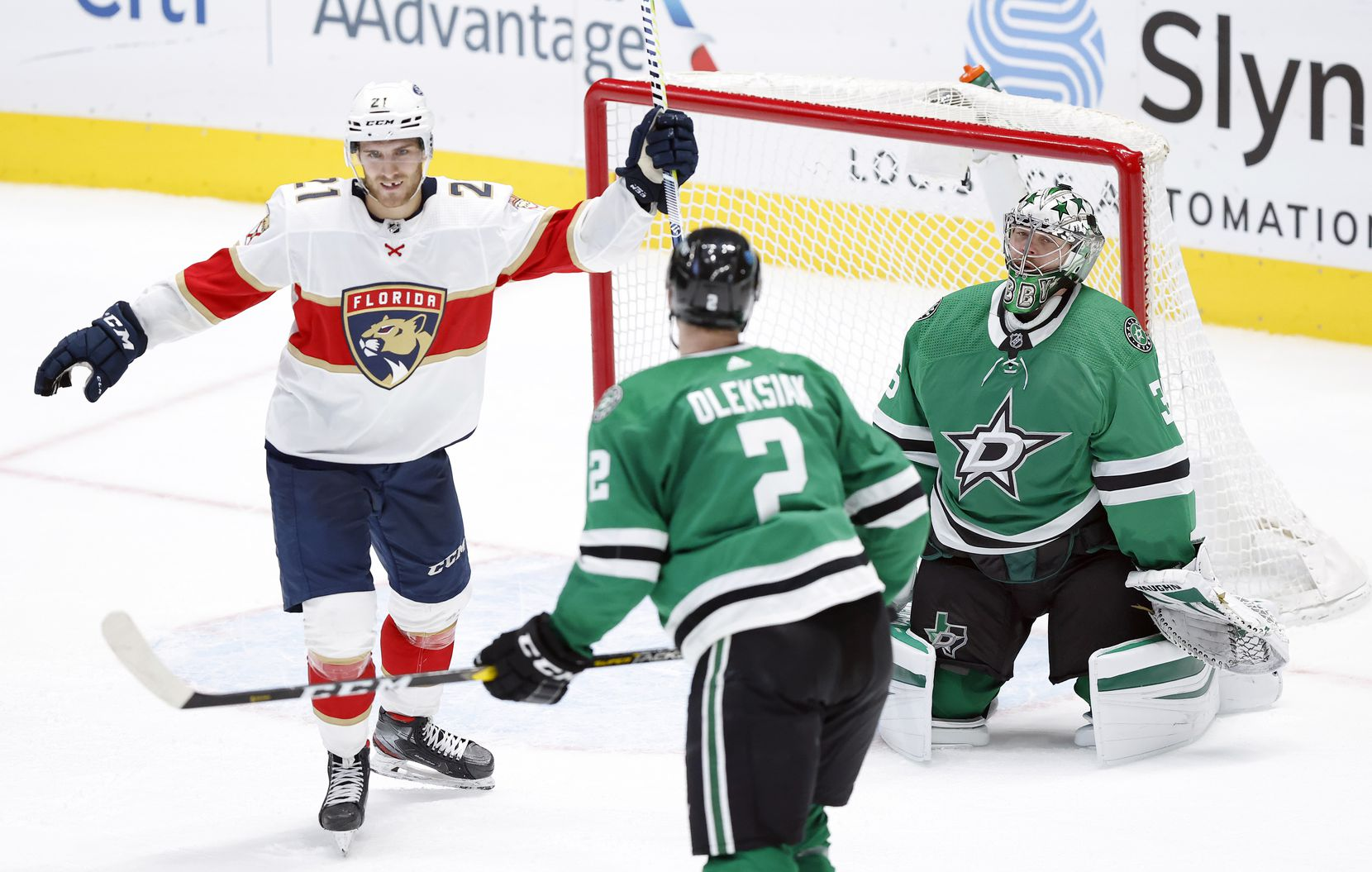 Florida Panthers center Alex Wennberg (21) celebrates center Frank Vatrano's overtime goal on Dallas Stars goaltender Anton Khudobin (35) at the American Airlines Center in Dallas, Tuesday, April 13, 2021. The Stars lost, 3-2. (Tom Fox/The Dallas Morning News)