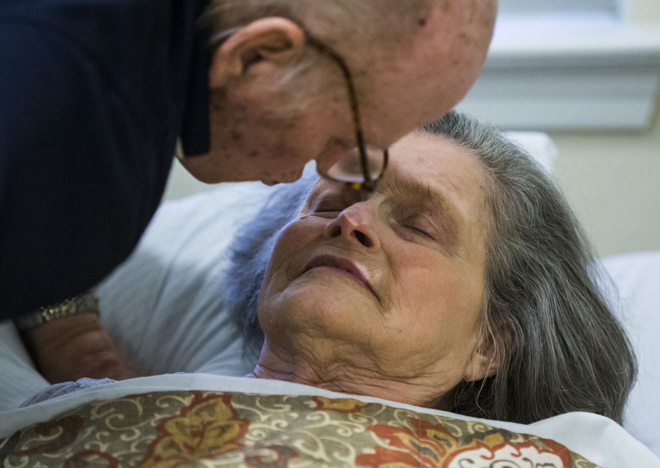 Bob Stiegler leans in to kiss his wife, Norma.