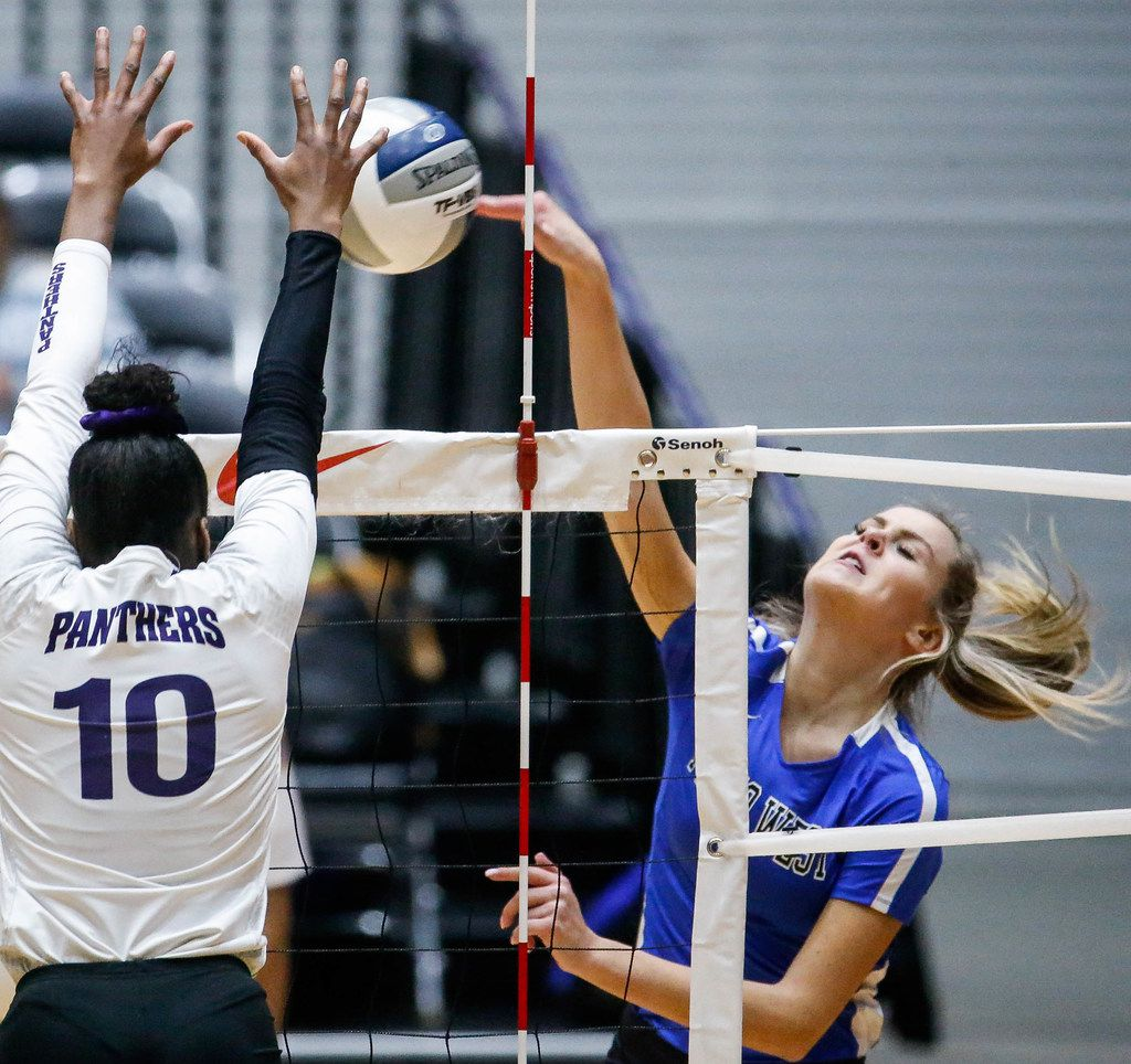 Plano WestÕs Noelle Piatas (6) tips the ball over the net during the first match of a Class 6A volleyball state semifinal match between Plano West and Fort Bend Ridge Point at the Curtis Culwell Center in Garland, on Friday, November 22, 2019. Plano West won the first set 25-21. (Juan Figueroa/The Dallas Morning News)