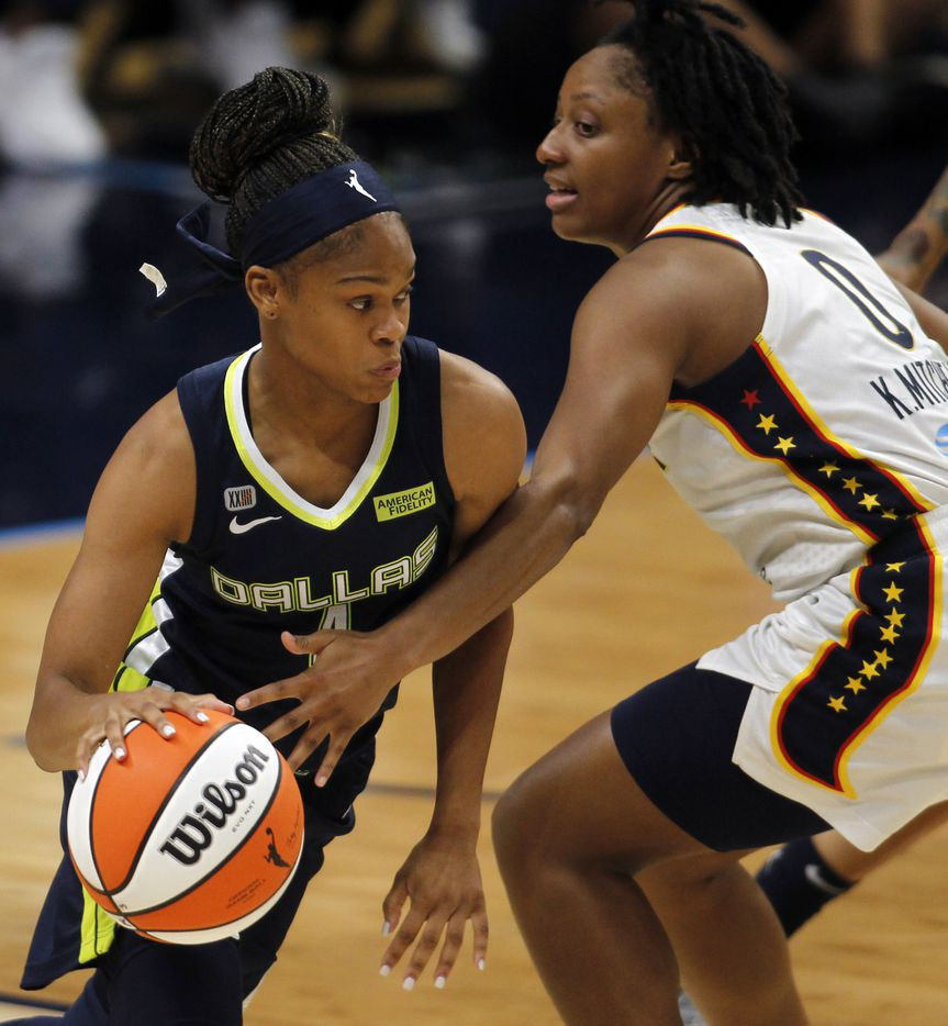 Dallas Wings guard Moriah Jefferson (4), left, drives around the defense of Indiana fever guard Kelsey Mitchell (0) during first half action. The Dallas Wings hosted the Indiana Fever for their WNBA game held at College Park Center on the campus of UT-Arlington on August 20, 2021. (Steve Hamm/ Special Contributor)