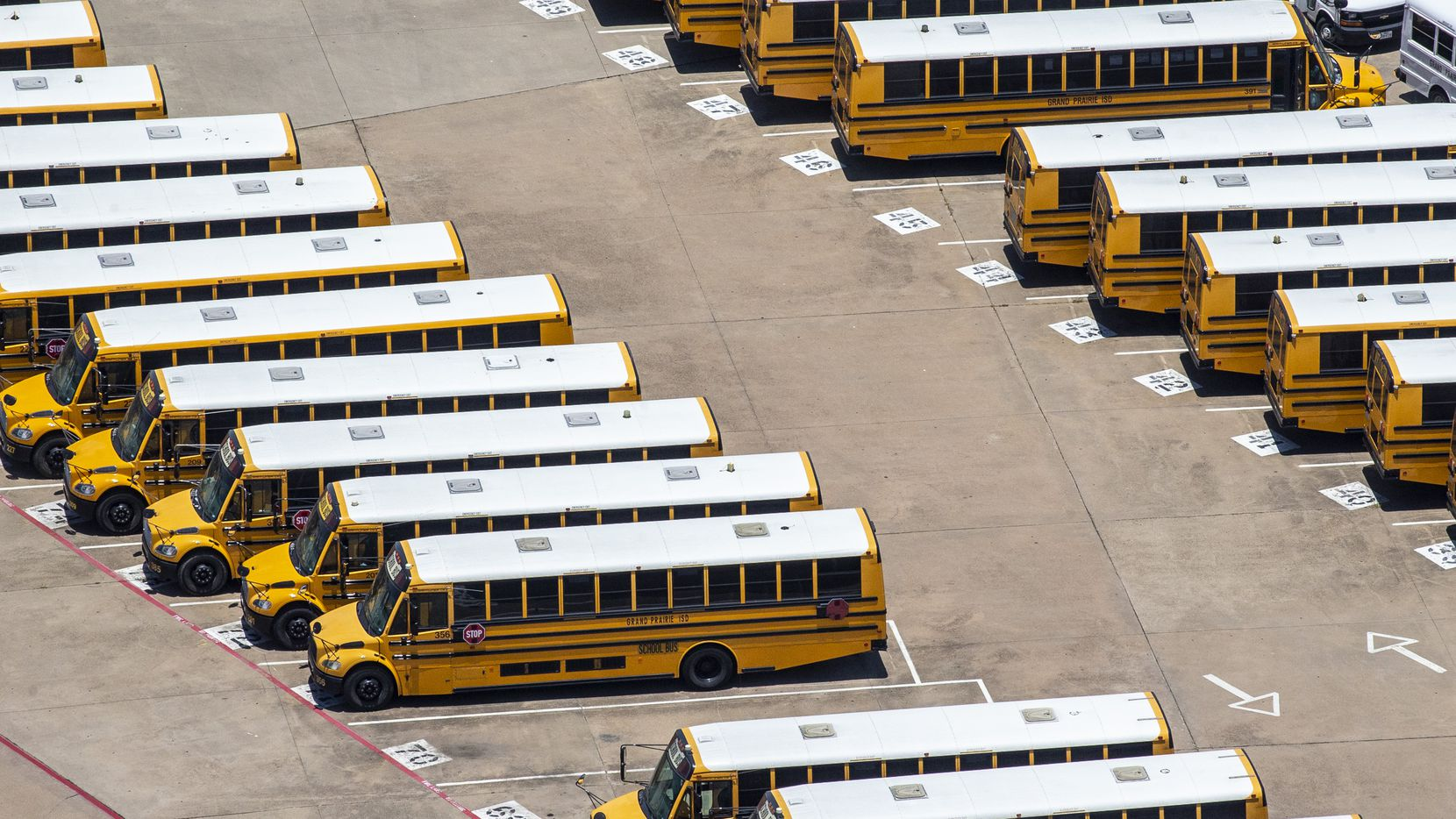 Buses are lined up at the Grand Prairie ISD Maintenance and Operations building in Grand Prairie, Texas, on Thursday, June 18, 2020. (Lynda M. Gonzalez/The Dallas Morning News)