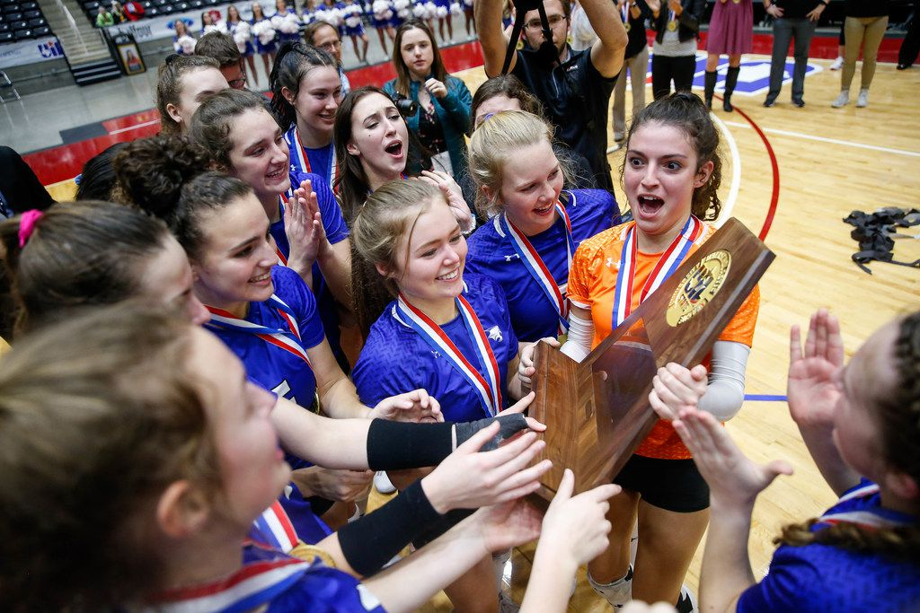 Trophy Club Byron Nelson Bobcats celebrate after winning the class 6A volleyball state final match against Plano West at the Curtis Culwell Center in Garland, on Saturday, November 23, 2019. Nelson won the fifth set 15-7 to become the title champions. (Juan Figueroa/The Dallas Morning News)