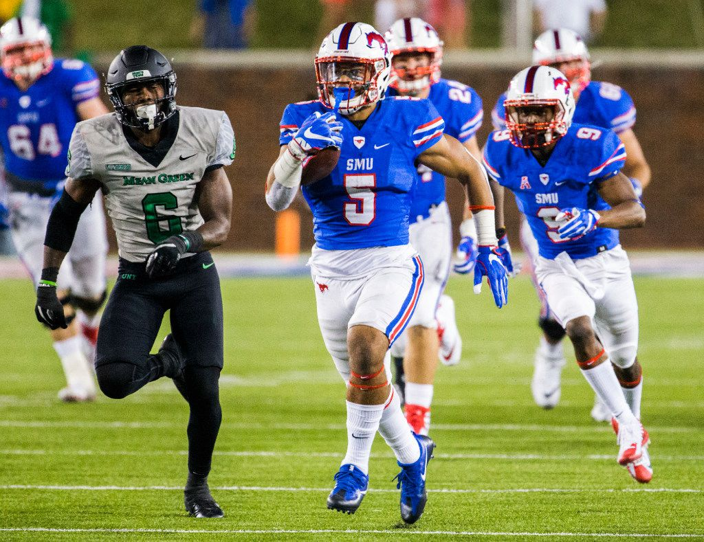 Southern Methodist Mustangs running back Xavier Jones (5) runs to the end zone for a touchdown during the third quarter of a football game between UNT and SMU on Saturday, September 9, 2017 at SMU's Ford Stadium in Dallas. (Ashley Landis/The Dallas Morning News)
