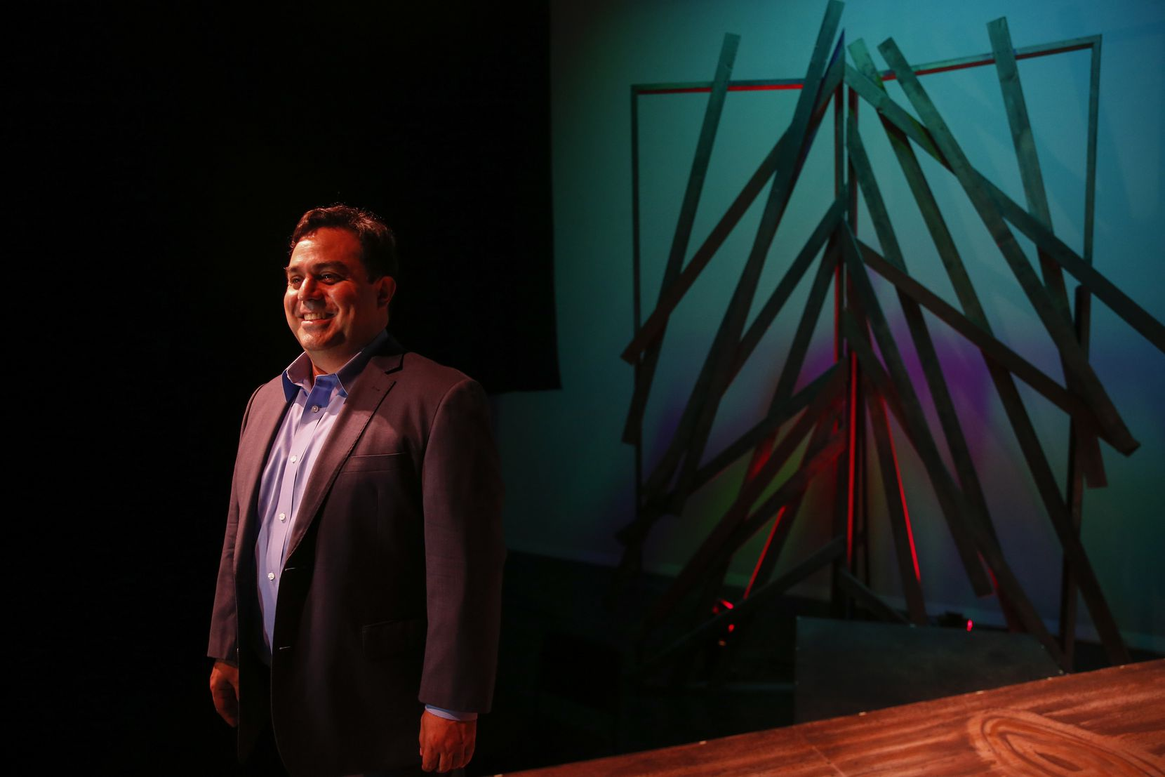 David Lozano, the executive artistic director of Cara Mia Theatre, poses for a photograph on Wednesday, Dec. 11, 2019 at the Latino Cultural Center in Dallas.