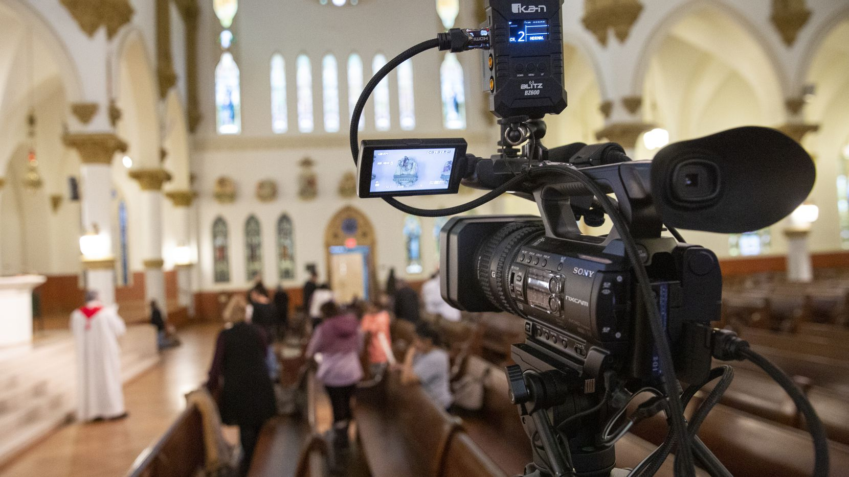 The Diocese of Dallas films Rev. Stephen Bierschenk pray the Stations of the Cross at the Cathedral Santuario de la Virgen de Guadalupe on March 13, 2020 in Dallas.