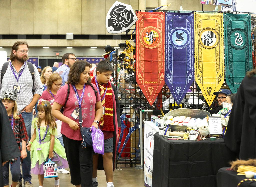 Attendees walk past rows of booths selling a variety of items at LeakyCon.