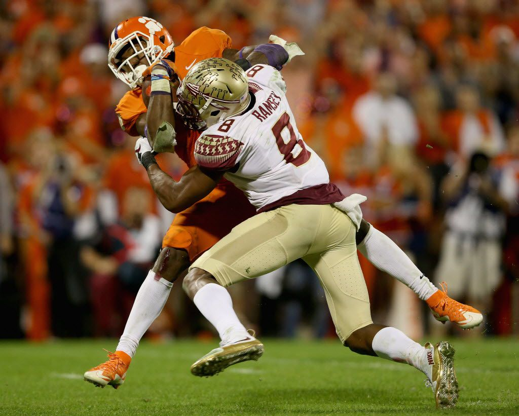 CLEMSON, SC - NOVEMBER 07:  Jalen Ramsey #8 of the Florida State Seminoles misses a tackle against Wayne Gallman #9 of the Clemson Tigers during their game at Memorial Stadium on November 7, 2015 in Clemson, South Carolina.  (Photo by Streeter Lecka/Getty Images)