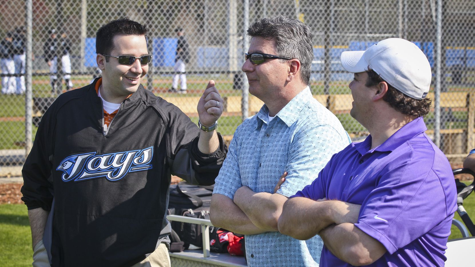 Feb 16 2011- An animated Blue Jays G.M. Alex Anthopoulos talks with Tony LaCava, and Director of Pro Scouting Perry Minasian (right) during the 3rd day at the Cecil B. Englebert Complex, in Dunedin, as pitchers and catchers report for spring training. (Photo by David Cooper/Toronto Star via Getty Images)