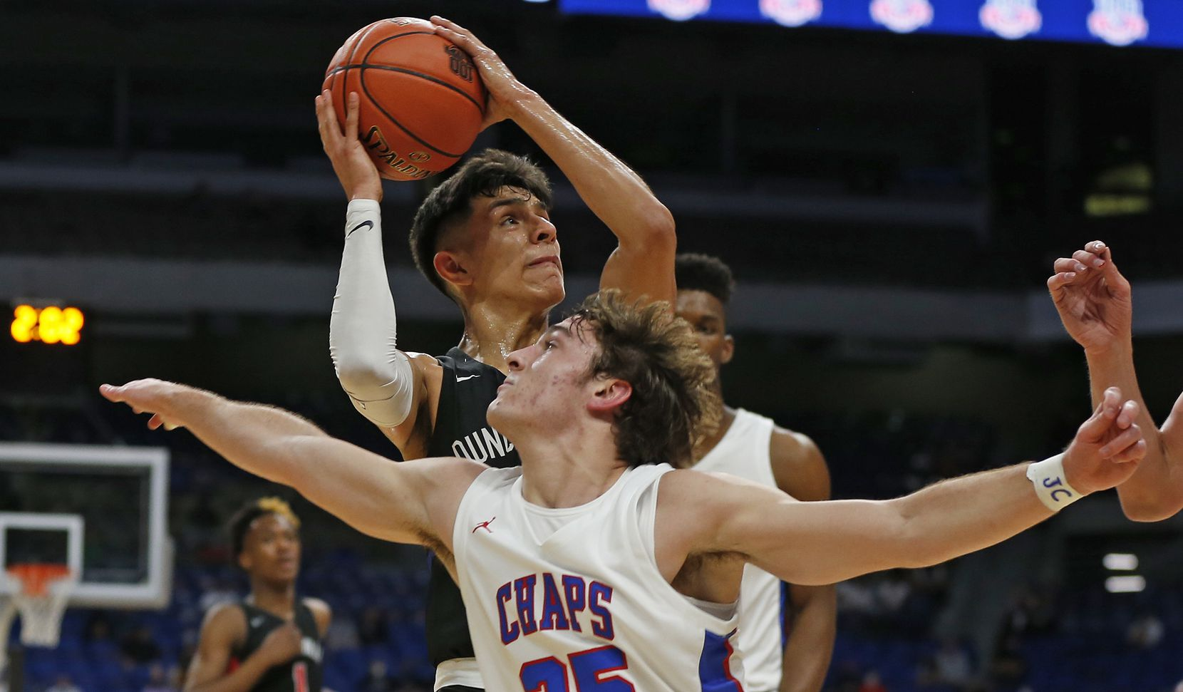 Duncanville Juan Reyna #20 drives by Westlake Eain Mowat #25. UIL boys Class 6A basketball state championship game between Duncanville and Austin Westlake on Saturday, March 13, 2021 at the Alamodome.