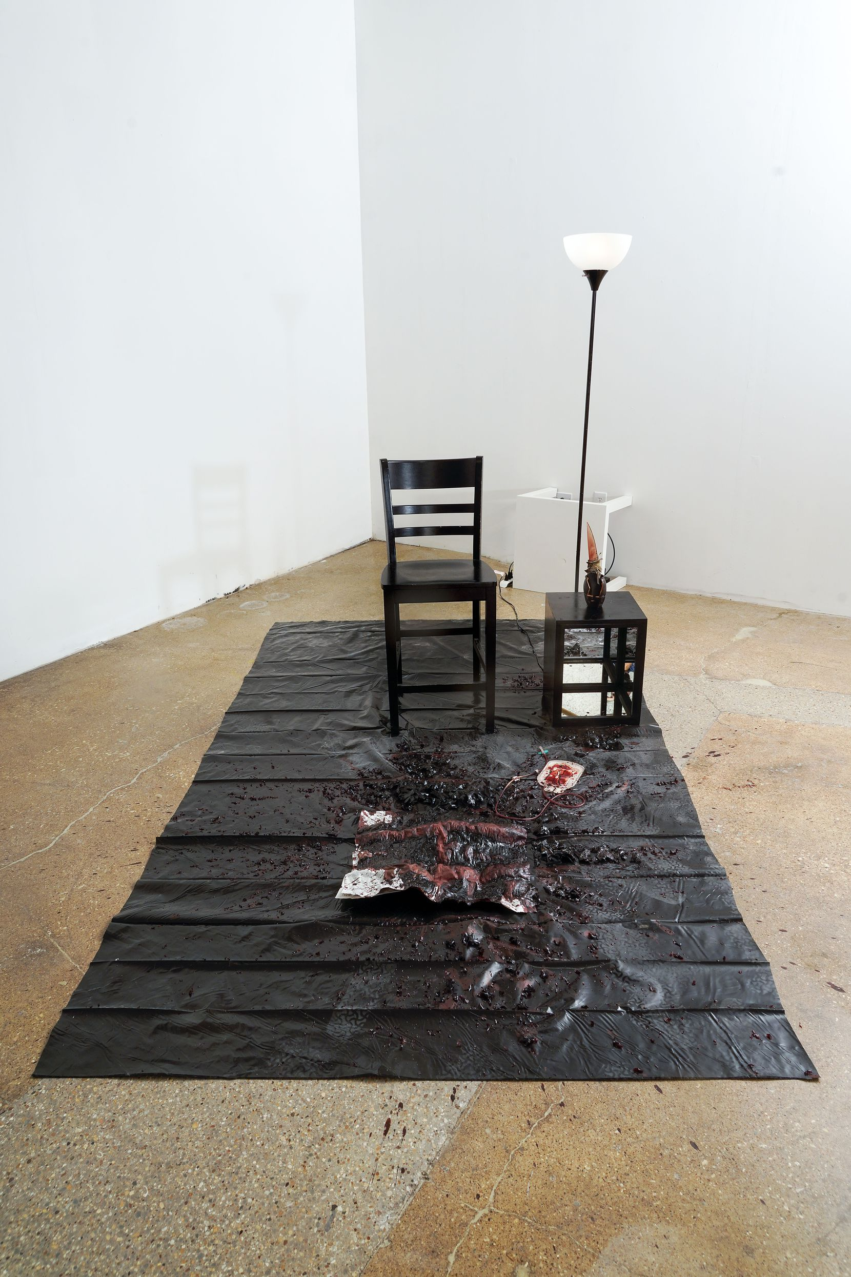 "The remnants of a performance art piece by Xxavier Edward Carter, ""Black Summer,"" 2020, performance installation, blood, cloth, plastic, metal, mirror, wood, paper"