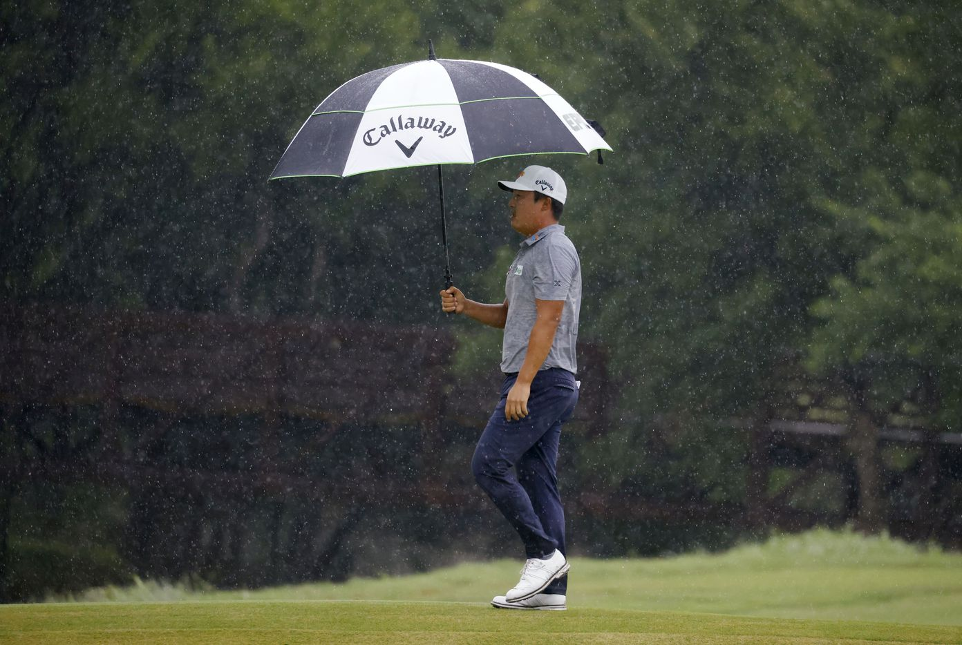 Kyoung-Hoon Lee walks the green on the 9th hole as it rains during round 4 of the AT&T Byron Nelson  at TPC Craig Ranch on Saturday, May 16, 2021 in McKinney, Texas. (Vernon Bryant/The Dallas Morning News)
