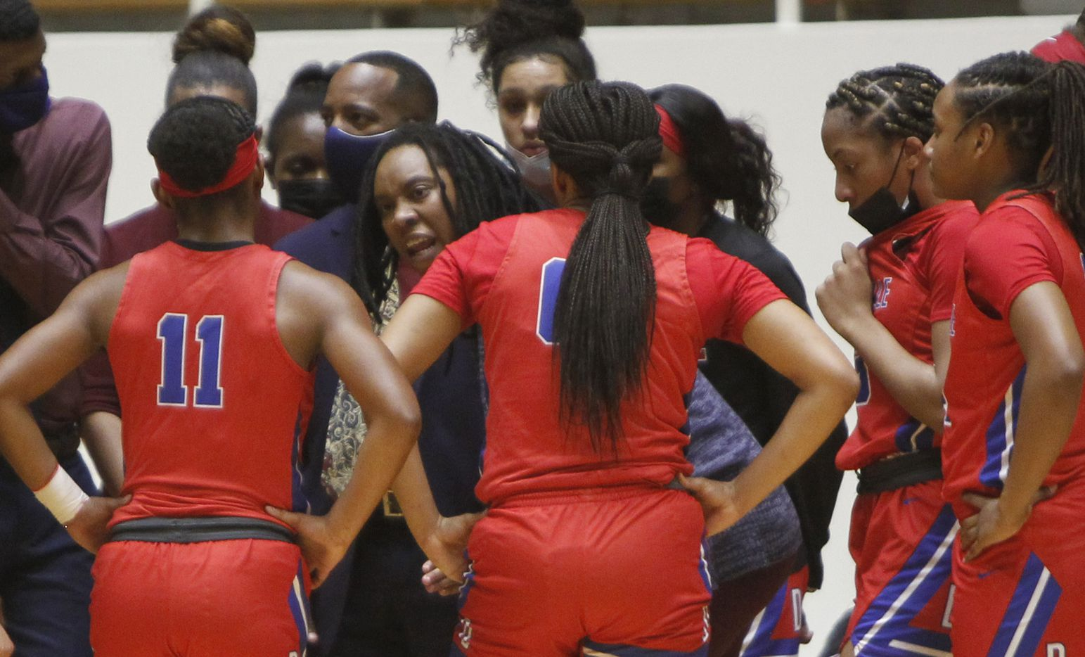 Duncanville Pantherettes head coach LaJeanna Howard speaks with her players during the first half of their game against Mesquite Horn. The two teams played their Class 6A area-round playoff basketball game at Loos Field House in Addison on February 23, 2021. (Steve Hamm/ Special Contributor)