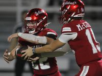 Dallas Woodrow Wilson quarterback Cam McGuire (15), right, hands the ball off to running back Nathan Barrilleaux (22) during a second quarter rush against Dallas Bryan Adams. The two teams played their District 6-5A Division 1 football game at Forester Field in Dallas on October 14, 2021. (Steve Hamm/ Special Contributor)