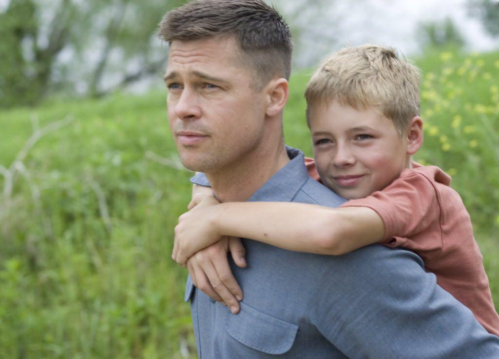 Brad Pitt (left) and Laramie Eppler star in The Tree of Life.