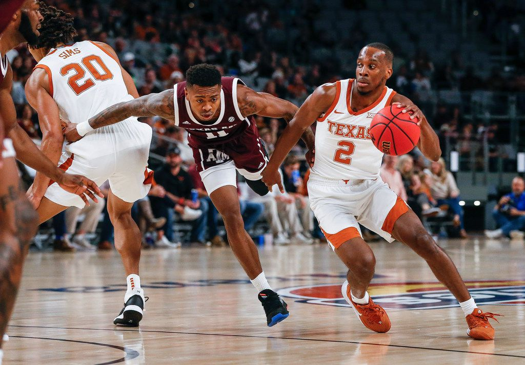Texas Longhorns guard Matt Coleman III (2) drives past Texas A&M Aggies guard Wendell Mitchell (11) during the first half of a basketball matchup between the Texas Longhorns and Texas A&M Aggies in the Lone Star Showdown on Sunday, Dec. 8, 2019 at Dickies Arena in Fort Worth, Texas.