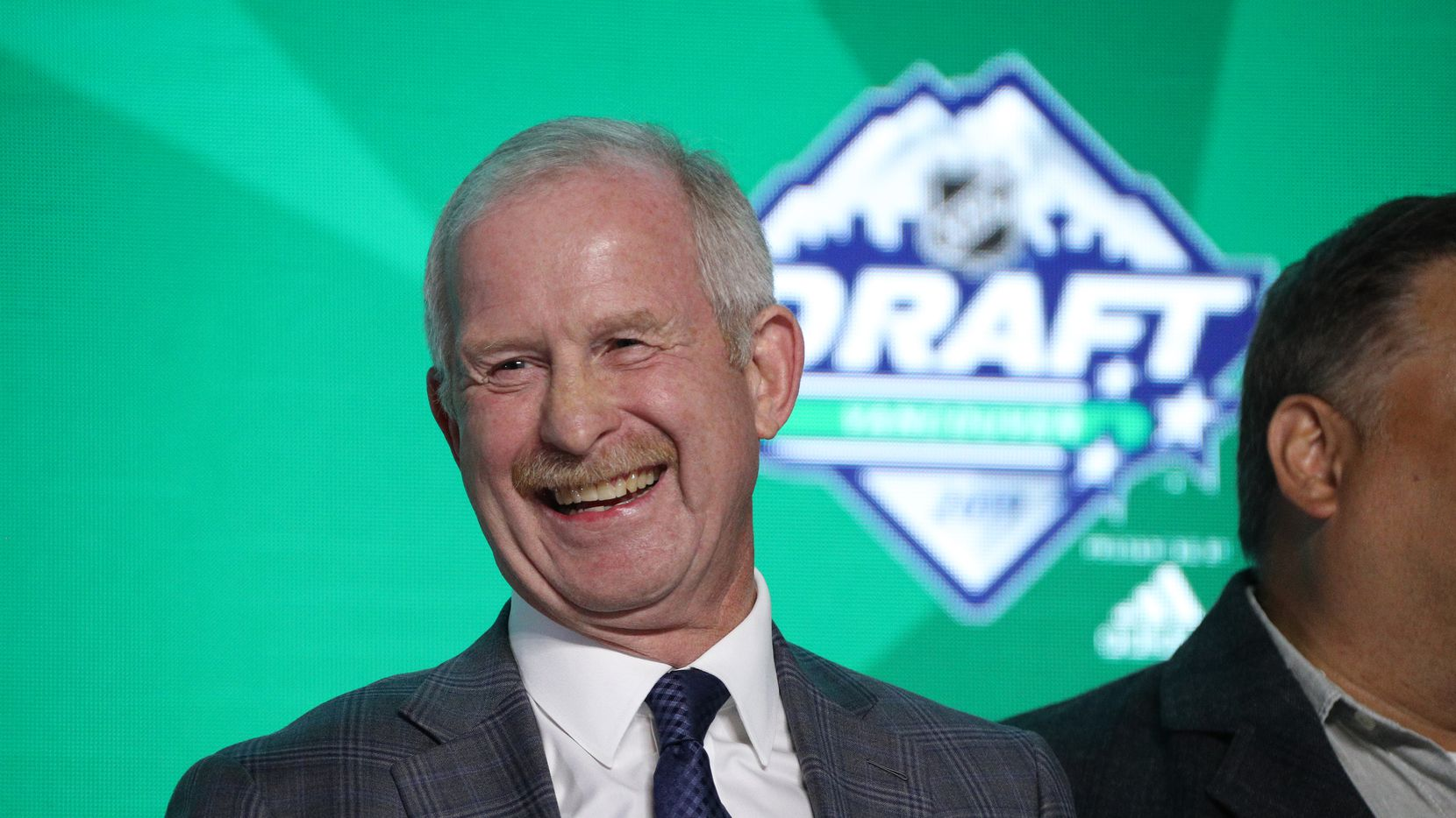 General Manager Jim Nill of the Dallas Stars stands onstage during the first round of the 2019 NHL Draft at Rogers Arena on June 21, 2019 in Vancouver, Canada.