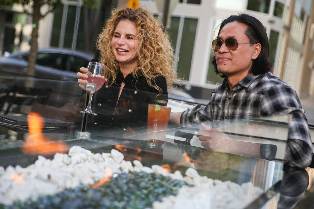Kimberly Chu and Khiem Chu at the outdoor fireplace table