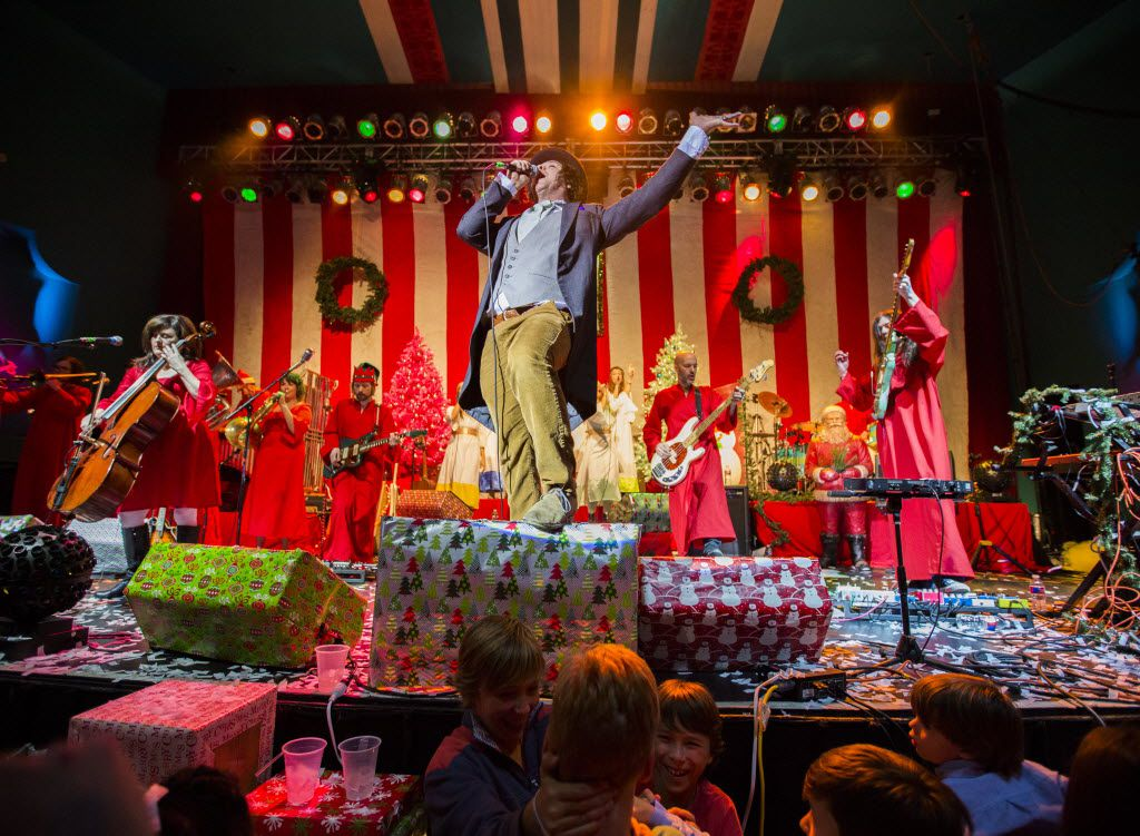 Tim DeLaughter, center, lead singer of The Polyphonic Spree, performs with other members during the band's 12th Annual Holiday Extravaganza.