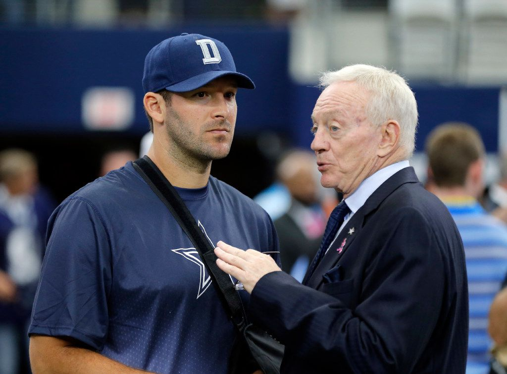 This Oct. 11, 2015 photo shows Dallas Cowboys owner Jerry Jones, right, talking with quarterback Tony Romo before an NFL football game against the New England Patriots in Arlington, Texas. Oct. 11, 2015. Jones honored DeMarcus Ware with the announcement that the franchise sacks leader would retire as a Cowboy, then engaged in a draft discussion centered largely on finding the team's next dominant pass rusher. It's exactly the opposite with Tony Romo, since the Cowboys have yet to pay homage to their 10-year starting quarterback as he heads to the broadcast booth while Dallas prepares for the start of the NFL draft feeling secure in the future under center. (AP Photo/Brandon Wade)