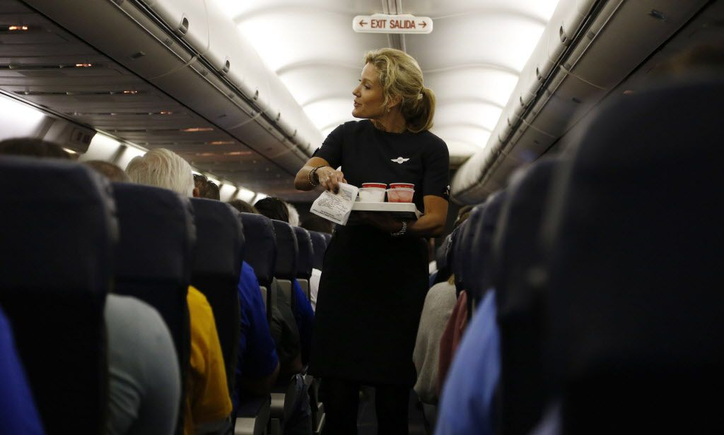 Southwest Airlines flight attendant Jenni Heikkinen handed out drinks on a Southwest Airlines flight to Denver in October 2014. (Vernon Bryant/The Dallas Morning News)