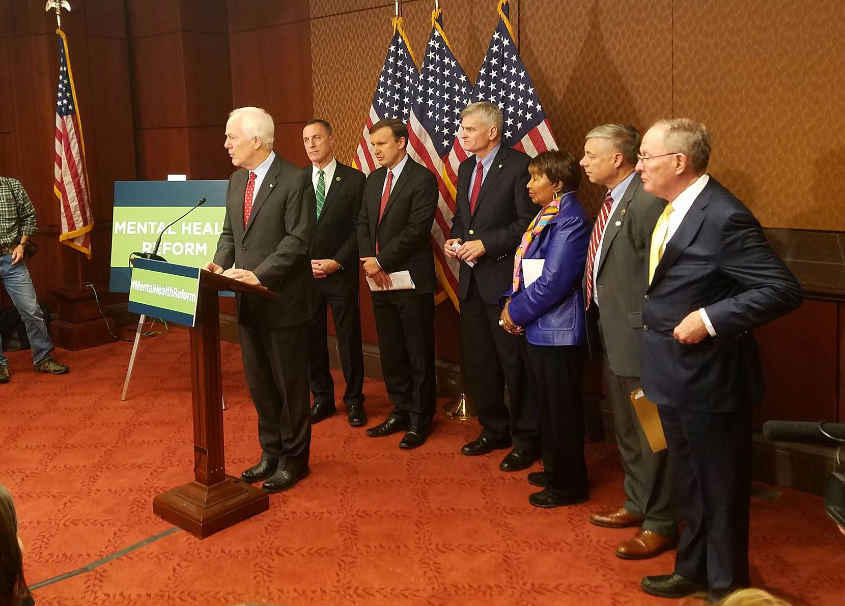 """Texas Sen. John. Cornyn, flanked by Rep. Eddie Bernice Johnson and other lawmakers, cheered the mental health measure as a way to help Americans get the """"sort of treatment they need in order to turn their lives around."""" (Tom Benning/Staff)"""