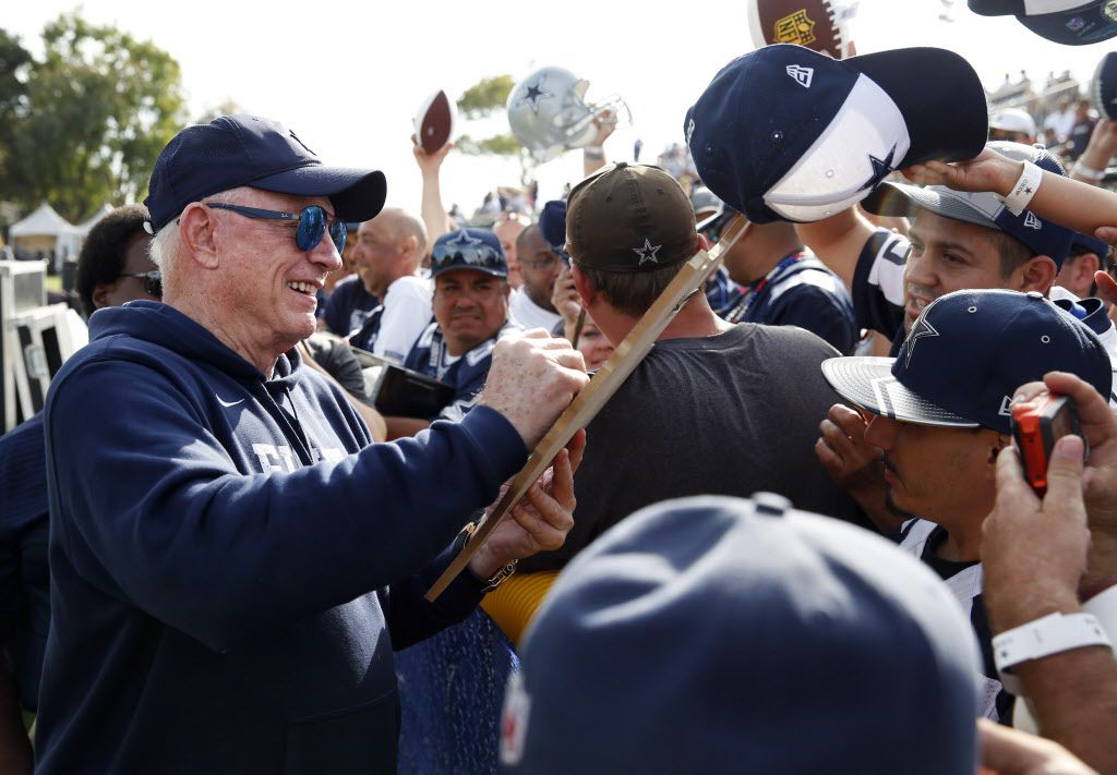 Dallas Cowboys owner and general manager Jerry Jones gives out his autograph during the afternoon practice at training camp in Oxnard, California on Monday, July 24, 2017. (Vernon Bryant/The Dallas Morning News)
