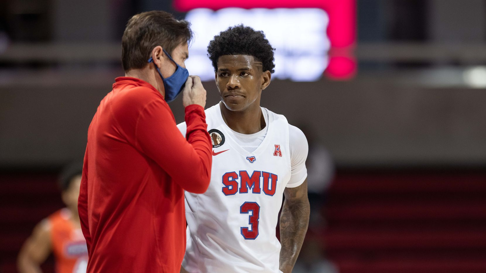 DALLAS, TX - DECEMBER 02: SMU Mustangs guard Kendric Davis (#3) talks to SMU Mustangs head coach Tim Jankovich during the college basketball game between the SMU Mustangs and the Houston Baptist Huskies on December 02, 2020, at Moody Coliseum in Dallas, TX.